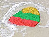 Flag Of Lithuania On A Stone On The Beach