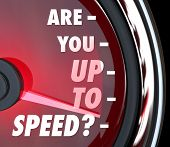 A red speedometer with the question Are You Up to Speed in words on the dial and the needle racing t