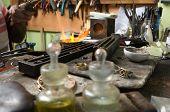 Jeweler melting gold bracelet with gasoline burner for making jewelry