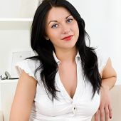 Young beautiful woman in a white blouse