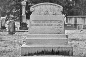 Black and White Photo of Old Tombstone
