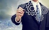 picture of interlocking  - Businessman with gears  - JPG