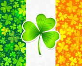 picture of triskele  - Vector Irish flag background made from green and orange clovers with big clover on it - JPG