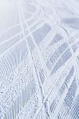 Skiing background - fresh snow on ski slope