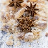 pic of christmas spices  - Star anise on brown sugar - JPG
