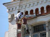 Man Washing Old Building