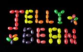 "picture of jelly beans  - ""Jelly Bean"" written with a variation of jelly beans, on a black background. - JPG"