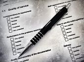 stock photo of barometer  - Pen laying on a customer satisfaction form - JPG