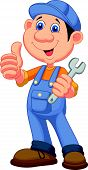stock photo of dungarees  - Vector illustration of Cute mechanic cartoon holding wrench and giving thumbs up - JPG