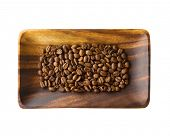 Coffee beans on acacia wood tray, Isolated on white.