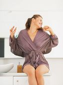 Young Woman With Toothbrush Stretching After Sleep In Bathroom