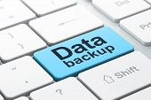 Information concept: Data Backup on computer keyboard background