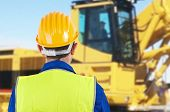 foto of blue-collar-worker  - Image of a Blue collar worker with hardhat - JPG