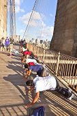 People Exercise Push-up At Brooklyn Bridge