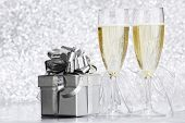 Beautiful silver christmas card with champagne and gift