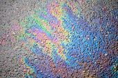 Background Texture Of An Oil Spill On Asphalt Road