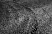 Dangerous Turn. Abstract Road Background With Tires Tracks On Dark Asphalt