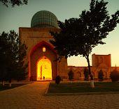 Illuminated oriental building in the complex of Bibi Khanym at twilight. Samarkand, Uzbekistan