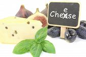 image of grated radish  - Piece of cheese with pepper figs grapes basil and blackboard - JPG
