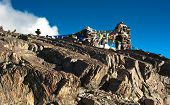 stock photo of manali-leh road  - Buddhist stone tower with praying flags at Himalaya mountain road pass at Manali  - JPG