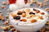 Healthy muesli breakfast with huts and raisin