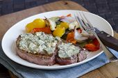 stock photo of cheese-steak  - Steak topped with melted blue cheese with roast vegetables - JPG