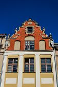 picture of tenement  - Facade of an ancient tenement in the old town square in Torun - JPG