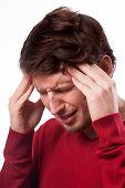 Man Suffering From Migraine