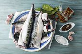 stock photo of chub  - A plate with fresh mackerel and spices on the kitchen table - JPG