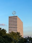 Image Of The Mercedes Benz Logo On The Rooftop Of A High Rise Building