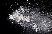 Flour in freeze motion, isolated on black background