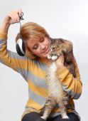 Portrait Of Young Girl With Cat