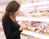 Girl Buys A meat In A Supermarket