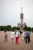 LUSHUN, CHINA - JUNE 10, 2012: Tourists at monument to Soviet soldiers, russian name Port Arthur, is now a naval base in China. Here was the main epicenter of the Russian - Japanese War of 1904-1905.