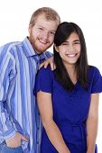 Happy Young Interracial Couple In Blue, Early Twenties Or Late