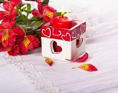 Red candle with heart and flower, a Valentine's Day card