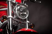 stock photo of headlight  - Color shot of a red motorcycle on a black background - JPG