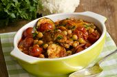 stock photo of tagine  - Moroccan chicken with chickpeas courgettes and cherry tomatoes - JPG