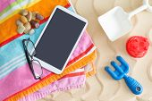 Tablet-pc On A Beach Towel With Glasses And Toys