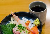 Japanese Style Raw Seafood Rice With Tea