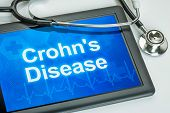 Tablet with the diagnosis Crohn's disease on the display