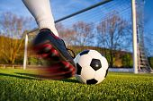 pic of football pitch  - Football or soccer shot with a neutral design ball being kicked with motion blur on the foot and natural background - JPG