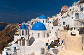 stock photo of cupola  - Ia town with blue cupola church and white buildings on the rock - JPG