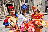 Three Cuban women in traditional dresses in Havana