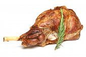 Roast leg of lamb on white background.