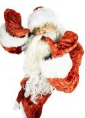 stock photo of contortion  - Santa Claus contorts funny mug on a white background - JPG