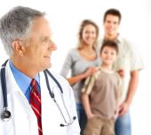 stock photo of medical doctors  - Smiling family medical doctor and young family - JPG