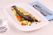 Fried Whole Trout With Vegetables And Cutlery
