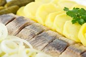 Portion Of Herring Fish Fillets With Potato Onion