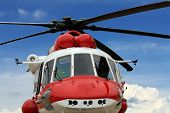 stock photo of rescue helicopter  - Multipurpose rescue helicopter front view on the background of cloudy skies - JPG